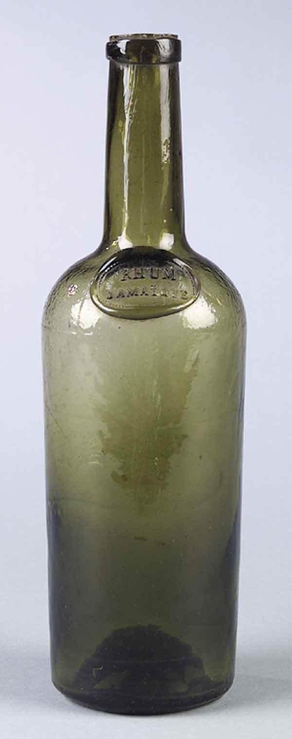 0669: Early Ochre Green Glass Bottle