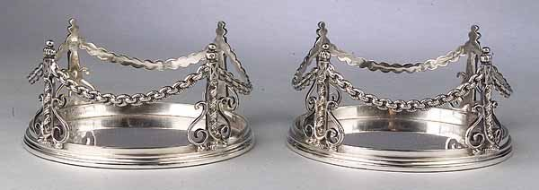 0593: Pair of Arts and Crafts Silverplate Magnum Coaste