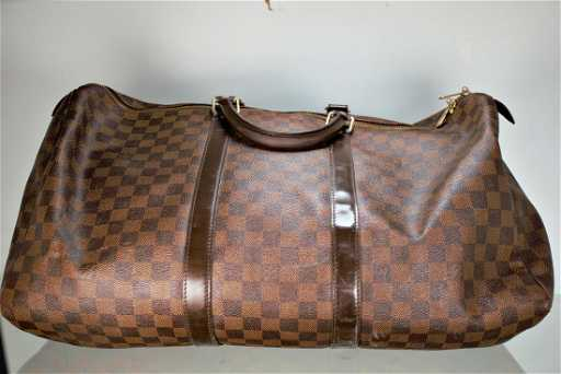 Louis Vuitton Keepall 50 Damier Ebene Canvas Duffle Bag. See Sold Price 092057b8840eb