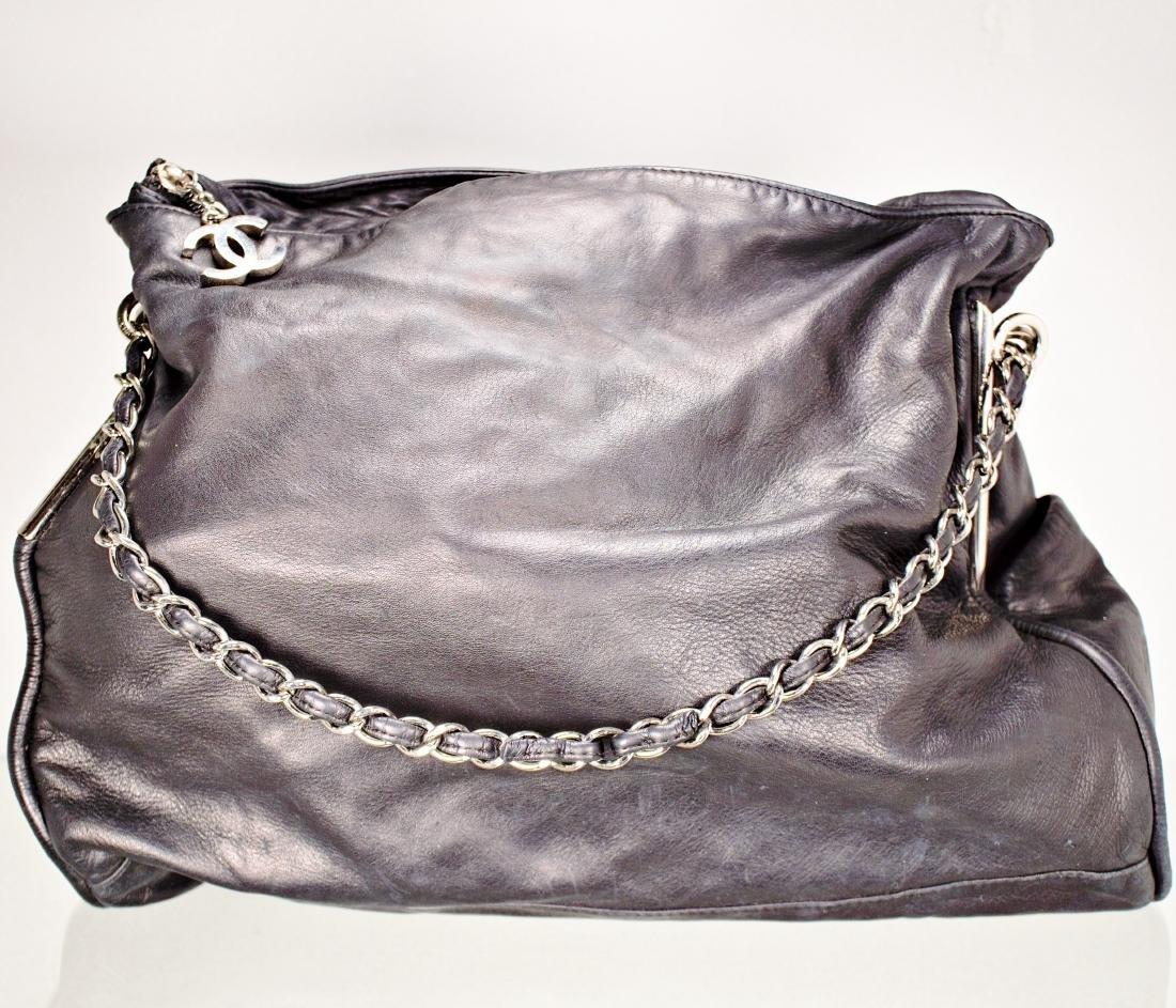 Lambskin Black Chanel Bag with Embossed Interlocking C