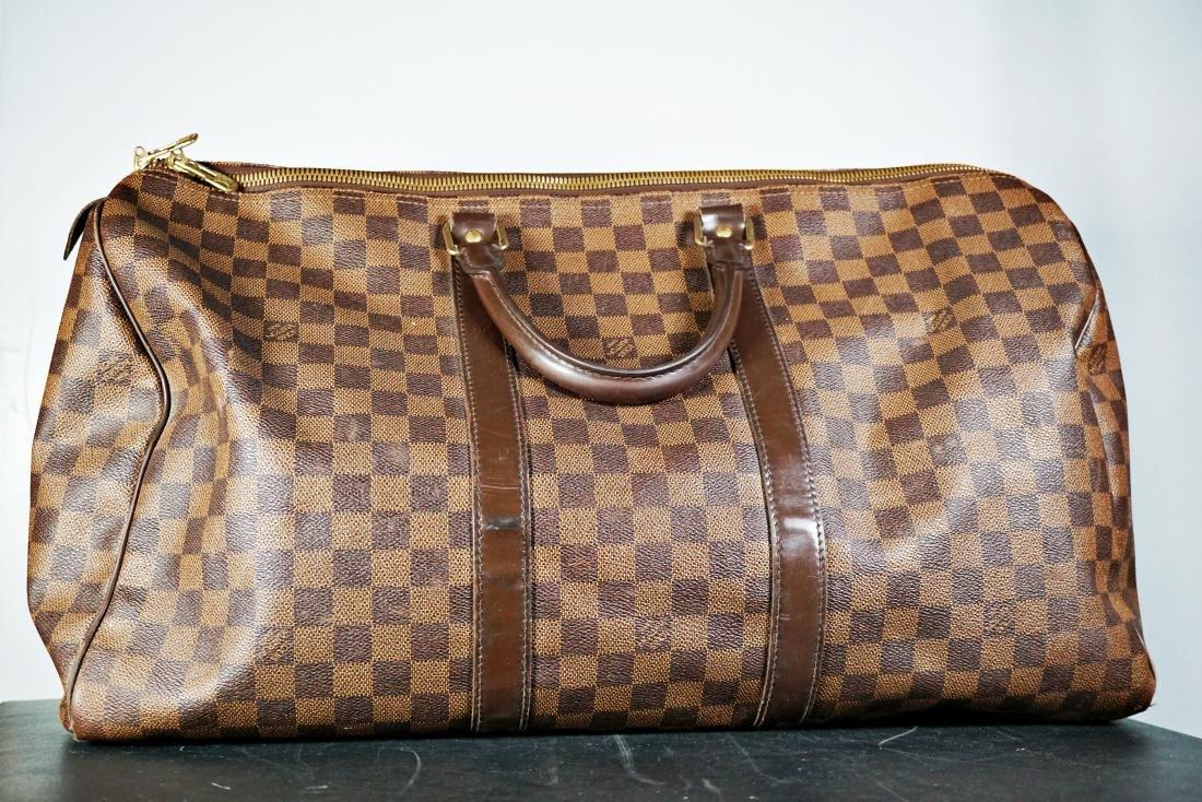 b7707bc0f8 Louis Vuitton Keepall 50 Damier Ebene Canvas Duffle Bag