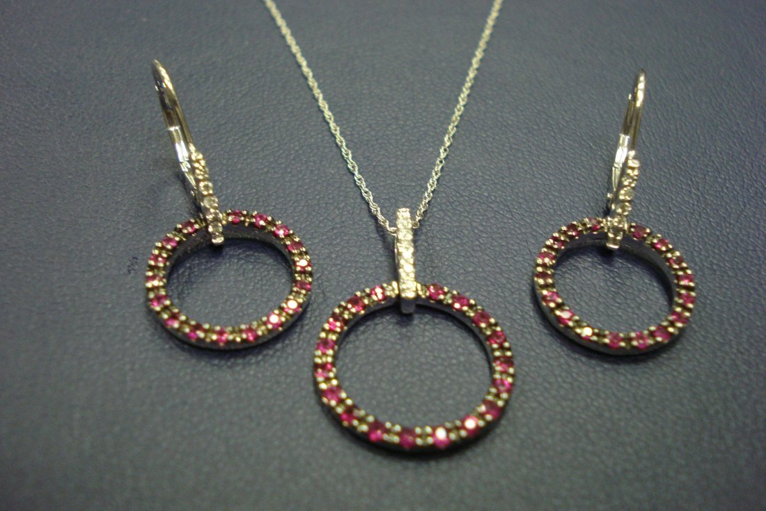 3 Piece 10k white gold diamond and ruby pendant and
