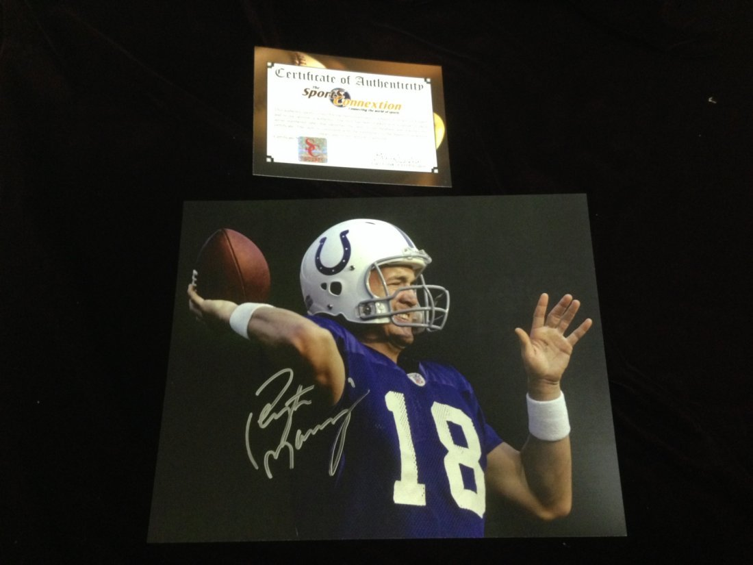 Peyton Manning autographed action photo