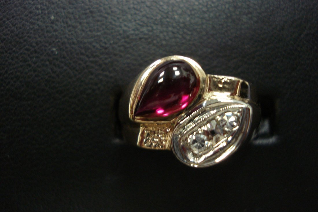 14k Two tone created ruby and diamond ring