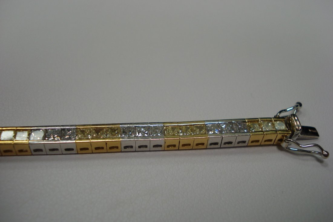 14k Two tone tennis bracelet with 7 carats of VS G