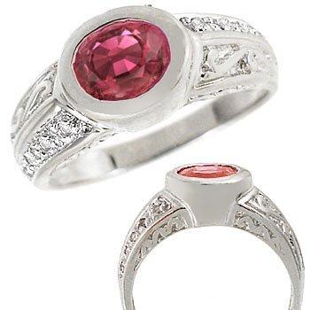 11: WG 1.32ct Pink Tourmaline oval .05ct dia ring