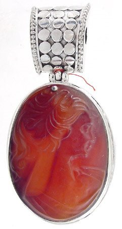1006: Silver 40 x 30 mm Carved Carnelian Cameo Pendant