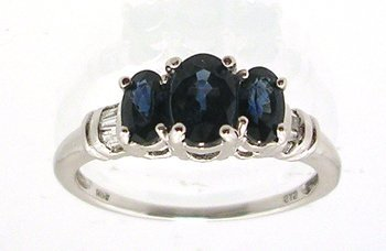 4111: 14KW 1.02ctw Blue Sapphire .08ctw Dia Three Stone