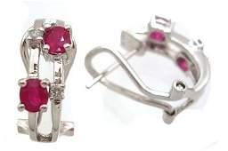 5235: 14KW .95ct Ruby Oval .07ct Diamond Omega Earring
