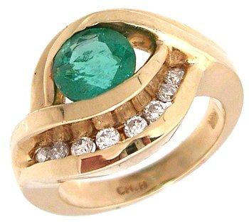 7110: 14KY 1ct Columbian Emerald rd .27 Dia chan Ring