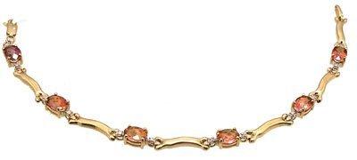 1103: 14kty 5.4cttw Twilight Topaz Oval Diamond bracele