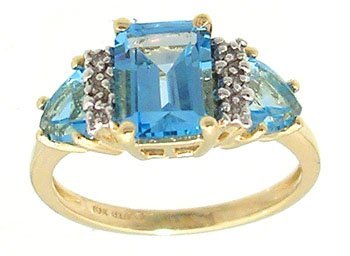 1301: 10KY 1.50ct Blue Topaz ecut/ trillion Dia ring