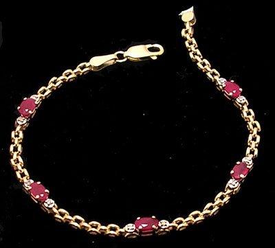 2105: 10ky 1.15ctw Ruby Oval Diamond Chain Bracelet