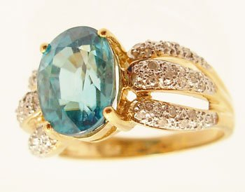 2107: 14ky 5.62ct Blue Zircon Oval .21ctw Diamond 2Tone