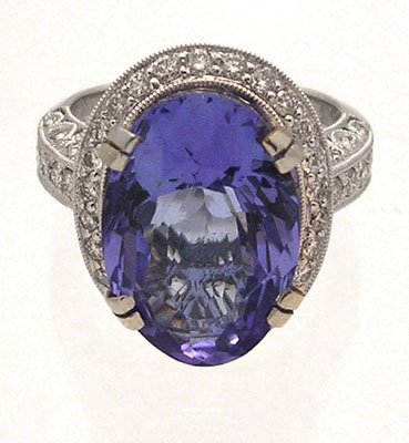 2187: 18kw10.30ct Tanzanite Oval 1.83ct Dia rd Ring App