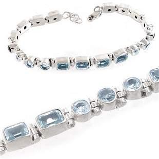 Silver Blue Topaz round/emerald cut 8in bracele