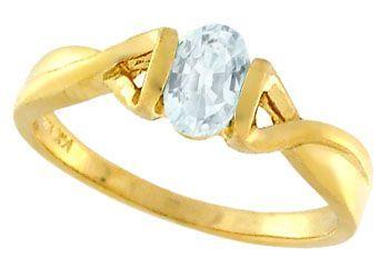 14KY .50ct Aquamarine oval 1/2 bezel ring