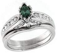 1064: WG .27ct Blue Diamond marquise .41ct Dia ring