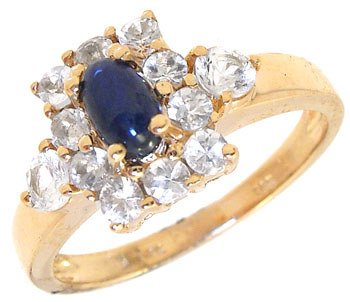 1276: 14KY 1.07ct Blue Cab White Sapphire band ring
