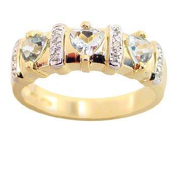 1281: .65ct aquamarine 3 trillion dia band ring