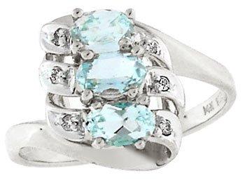 1282: 14KW .75ct Aquamarine 3 oval diamond ring