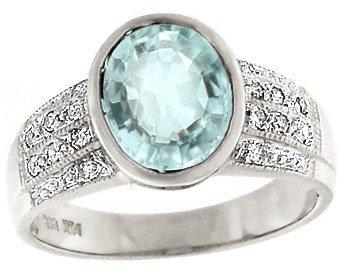 1283: 14KW 2.05ct Aquamarine oval bezel Dia ring