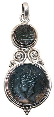 2297: Sterling Indian George coin pendant