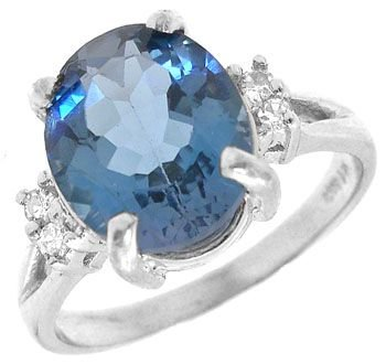 3255: 14KW 4ct Blue topaz oval Dia ring
