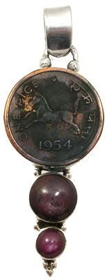 3272: Sterling Star ruby Indian 1950s coin pendant