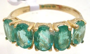 4010: YG 2cttw Columbian emerald 5 oval band ring