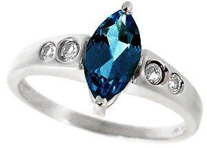 4261: WG 1.25ct Blue Topaz marq .16 White Sapphire ring