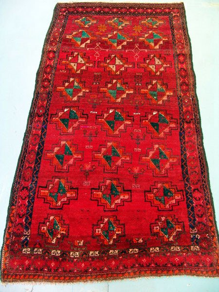 1298: Persian Khamseh rug measuring 7 ft x 3 ft 8 inche