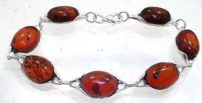 2253: Sterling Red Amber 14x10m oval bezel bracelet: 65