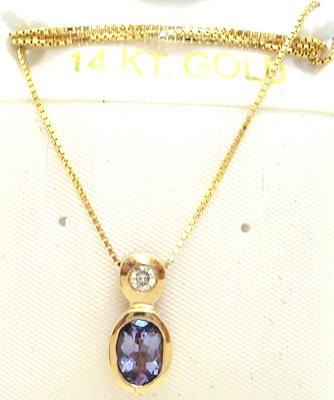 2265: 14KY .75ct Tanzanite oval Diamond bezel pend/chai