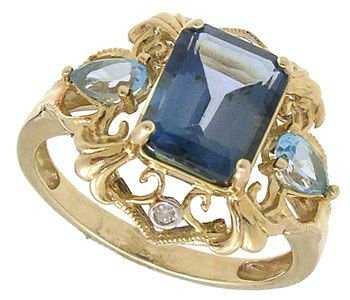 261: 10KY Blue Topaz E-cut Marq Dia ring
