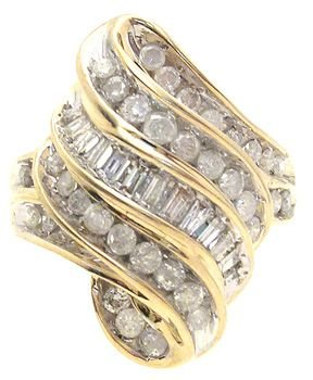 1264: 10KY 1cttw Diamond Channel/Bagg. set Curve ring