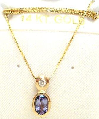 3254: 14KY .75ct Tanzanite oval Diamond bezel pend/chai