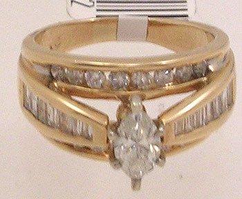 835: 14KY 1.50cttw Diamond marq bagguette rd ring