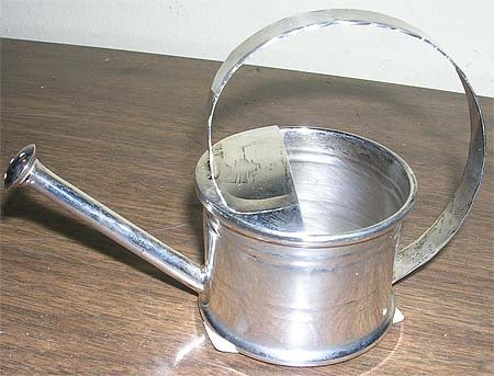 5: Sterling Cartier Watering Can
