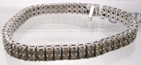 2491: 14KW 9.65cttw Diamond Bracelet 27gramsAPPRAISAL