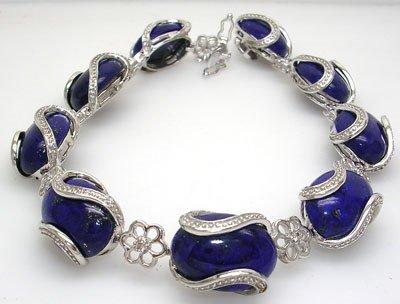 4808: 14KW 49ct Lapis Oval Diamond Bracelet