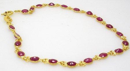 834: 18KY 3cttw Ruby oval bracelet 7inch