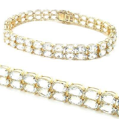 19:14Kt YG 14ct Aquamarine double row oval bracelet 7