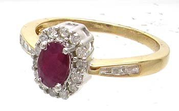 2653: 14KY Ruby Oval .25ct Diamond Round Bagg Ring