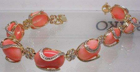 2836: 14KY 27ct Coral Oval .09ct Diamond Bracelet