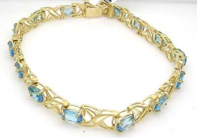 2840: 10KY 7.5in Oval Blue Topaz X-O Design Bracelet