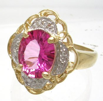 3826: 14KY 2ct Pink Topaz Oval Diamond Flower Ring