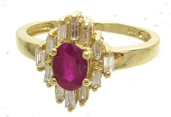 3835: 14KY .20ct Ruby Oval .20ct Diamond Bagg Ring