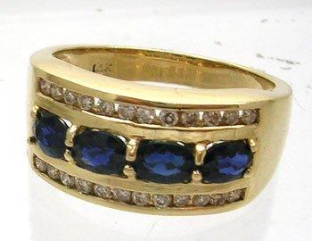 387: 14KY .80ct Blue Sapphire .25ct Diamond Ring