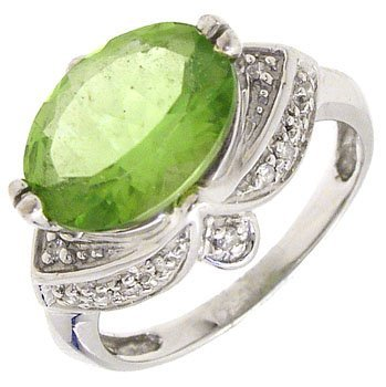 828: 14KW 2.50ct Peridot oval dia estate style ring